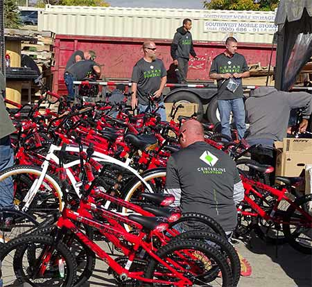 Volunteers from Centerline Solutions' Denver office assembled many of the 330 Huffy bicycles that the company provided to children across the country. They delivered them to elementary school-age students who beamed with delight after receiving their first bicycle.