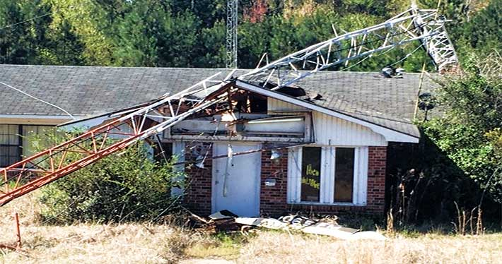 There were no injuries when this guyed tower collapsed yesterday, damaging an unoccupied building, but a tower developer says that it has been financially hurt after a Cobb County , Ga. required it to to move its proposed structure to another location. Photo Courtesy: Screven County EMA