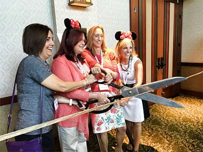 Event planner took the honors of cutting the ribbon to open the exhibit hall.