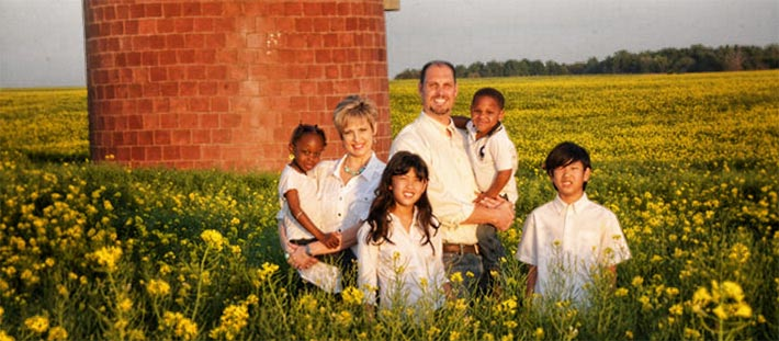 Miranda Allen, CEO of Radiofrequency Safety International, is pictured with her husband, Stephen, and their four children.