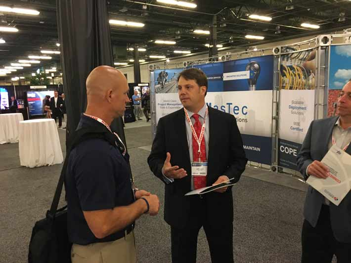 Jeff Lewis, right, discusses the industry's changing environment with Phil Larsen.