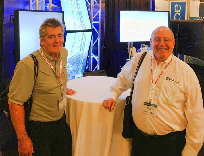 Pat Moore, left, and Don Doty take a breather while manning FDH Velocitel's booth.