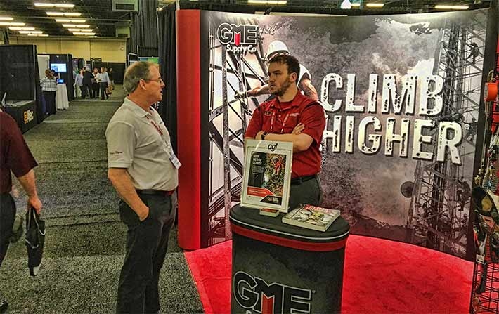 As the show winds down, Caleb Messer of GME Supply Co. talks to an attendee in the exhibit hall.