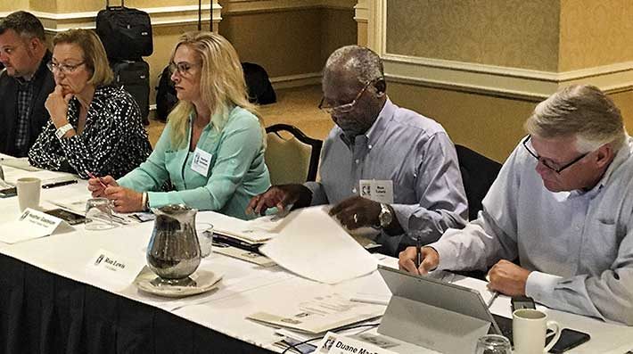 Pictured, from left to right, during one of the Board meetings are Brandon Chapman, Yanna Patton, Heather Gastelum, Ron Lewis and Duane MacEntee.