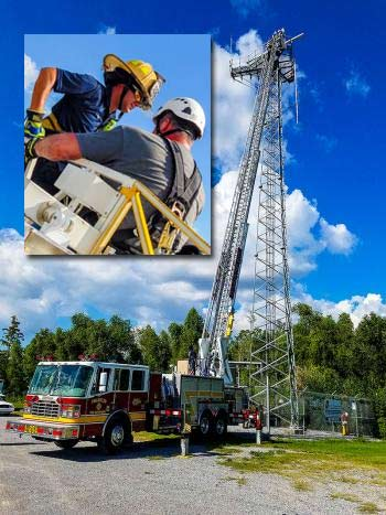 Franklin Firefighter Adam Fangue rescues service technician Gary Leger of Patterson from a radio tower in Berwick, La. after Leger got stuck at the top of a 100-foot ladder due to heat exhaustion.