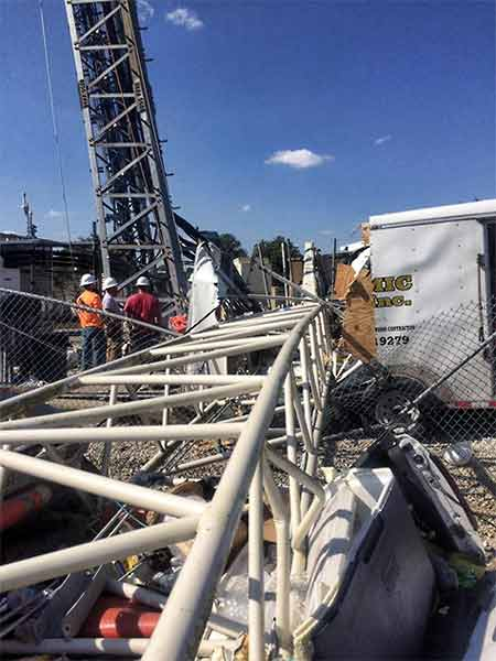 Crew members of Dynamic South were uninjured when a crane came inches away from knocking down a 350-foot tower when it collapsed.