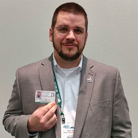 Ryan Schock, Vice President of Operations for Design Telecommunications of Charlottesville, Va., proudly displays his TTT-1 and TTT-2 certification card, the first one issued by NWSA. Schock is also an NWSA TTT Examiner and a NATE WIN liaison.
