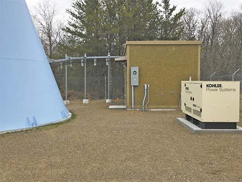 ALL DRESSED OUT AND NO WHERE TO GO TRANSMIT – Over $200,000 worth of equipment sits idle for lack of a six-foot easement to connect equipment to Polk Burnett Electric Utility power.