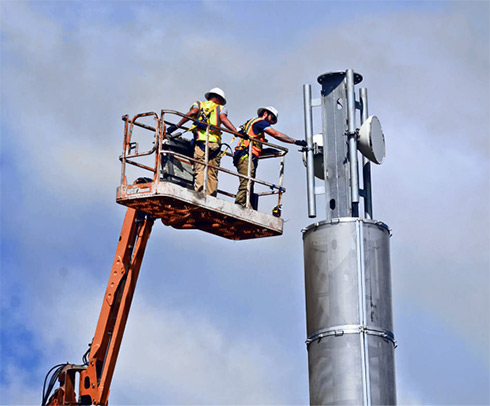 Two tower techs from Faith Technologies remove the Mobilitie mini-macro tower. Otherwise, the City of Goliad would have taken it down and sold it for scrap. Photo Credit: Bill Clough, Beeville Publishing Company