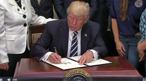 President Donald Trump signed an executive order on Thursday that looks to expand apprenticeships and job-training programs by giving more freedom to third-party companies and schools.