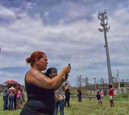 Pretzel-like antenna arrays and no backup power has residents struggling to get cell service in most areas of Puerto Rico.
