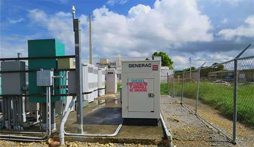 Although many sites are hardened, such as this Ponce self-supporting tower owned by American Tower, many of the island's structures are not. Even if gensets are in place, fuel delivery is a serious problem.
