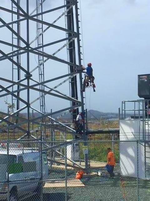 Tower techs work on a T-Mobile Puerto Rico cell site. The carrier said it has restored service to nearly 240 sites.