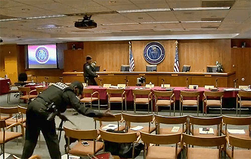 "In a highly unusual and frightening moment for reporters, guests and staffers, the commission's meeting room was evacuated briefly when Pai made the request to leave, stating it was ""on advice of security."" The cameras still streamed from the FCC's website and it showed dogs being brought in to search the room. Protesters had been outside FCC headquarters and numerous threats against the FCC, and particularly Pai have been made in recent weeks."