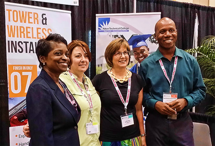FCC Chairman Mignon Clyburn was well-known for her support of net neutrality as well as her concern for tower climber safety. Pictured (from left) at an exhibit booth of Aiken Technical College are Clyburn, Molly Cooper, Dr. Gemma Frock and Nathaniel Hatchett
