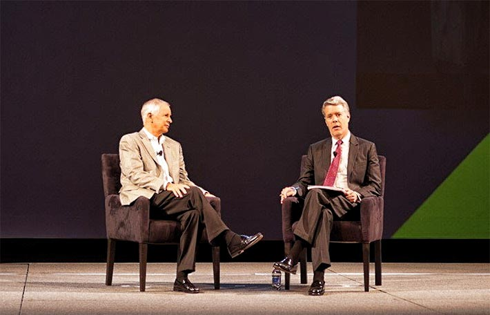 Dish Chairman Charlie Ergen (left) was interviewed by former FCC Commissioner Rob McDowell