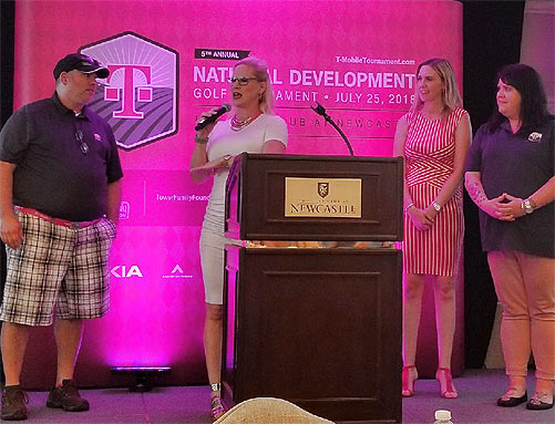 Leaders of  T-Mobile's National Development team, from left, Allan Tantillo, Heather Gastelum, Katie Miller and Stacie Harwood, take the stage to speak during the golf event's reception