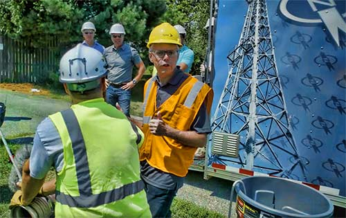 Combes talks to a capstan operator at the Kansas upgrade site