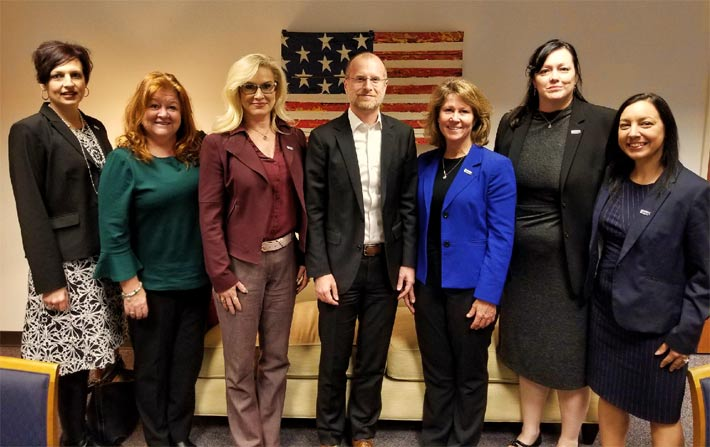 Pictured with FCC Commissioner Brendan Carr are, from left, Miranda Allen, Therese O'Brien, Heather Gastelum, Paula Nurnberg, Andy Lee and Shama Ray