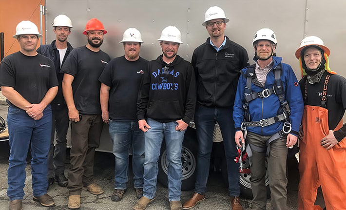 FCC Commissioner Brendan Carr, second from left, joins Vinculums crew members after he assisted in a carrier's network problem.