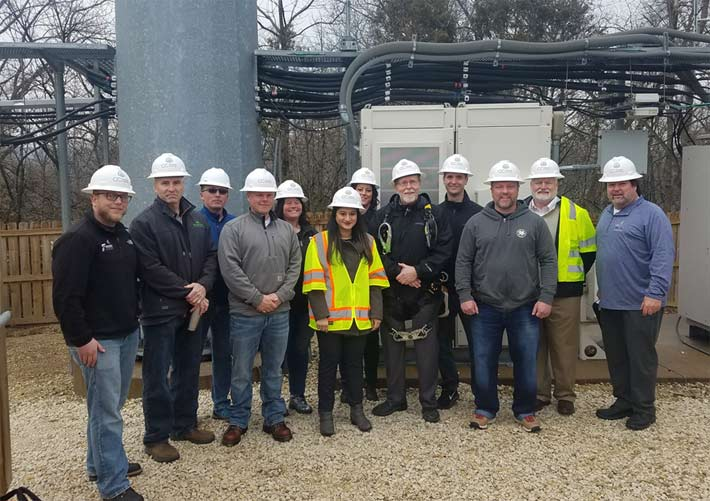 Congressman Dave Loebsack, in climbing gear, visited a Crown Castle site today in Iowa. The event served as a springboard for reintroduction of vital workforce development legislation.