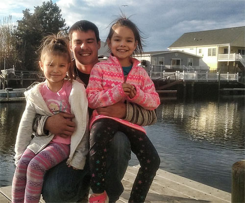 Proud father Devon Collins with his two daughters, ages 8 and 9.