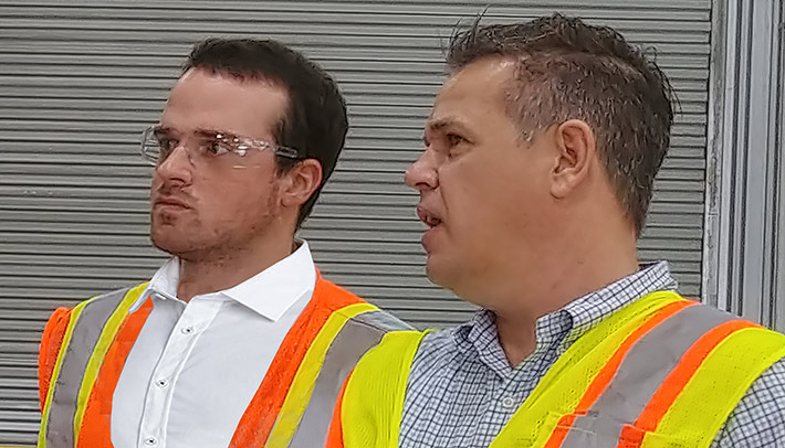 Evan Swarztrauber, left, is given a tour of CommScope's Euless, Tex. manufacturing facility by Vice President Darin Piburn