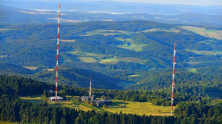 Three tower techs in Germany were killed when their man basket fell from the 164-foot level where they were installing a new antenna on the guyed tower at left