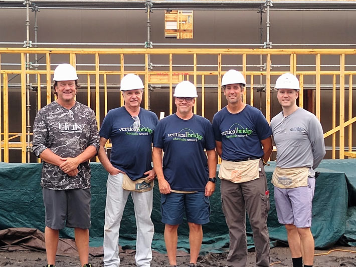 Vertical Bridge team members (from left) Bill Maxwell, Gustavo Figueiredo, Richard Biederwolf, Mike Szafoni and Steve Hedges at a Habitat for Humanity Build in Chicago.