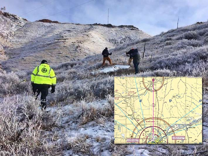 Investigators inspect wreckage from the Cessna that crashed on Dunn Mountain. The pilot had been heading from Billings to Roundup when he crashed. An aeronautic chart does not show the 185-foot guyed tower that he hit.