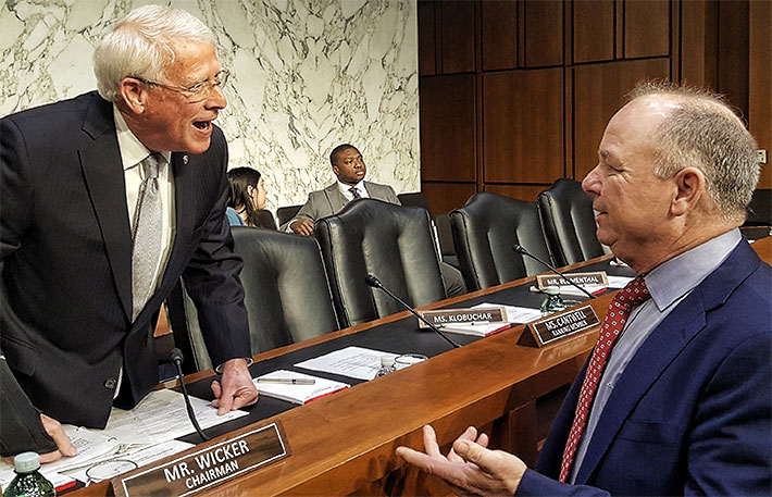NATE Chairman Jimmy Miller enjoys a private conversation with Senator Tom Wicker prior to this morning's hearing