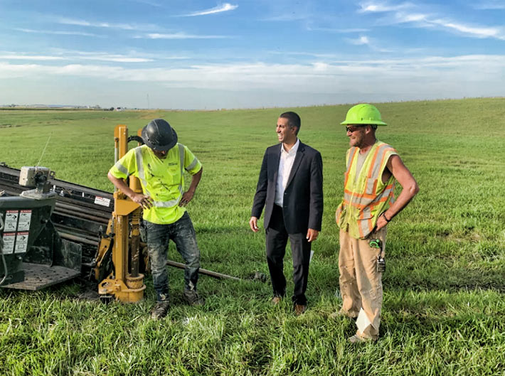 FCC Chairman Ajit Pai visits with workers laying fiber optic cable in North Dakota.