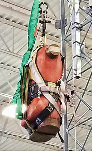 A 310-pound torso in a harness test weight was used in addition to an eight-foot sling safety strap to protect the test weight from hitting the laboratory floor