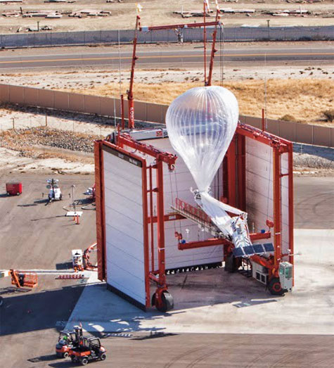 Loon's launch system has three wind walls and can be rotated so the opening where the balloon drifts out always faces downwind, ensuring the balloon is always sheltered from the elements. A custom apparatus fills the balloon with lift gas inside the launch system. Photo: Loon