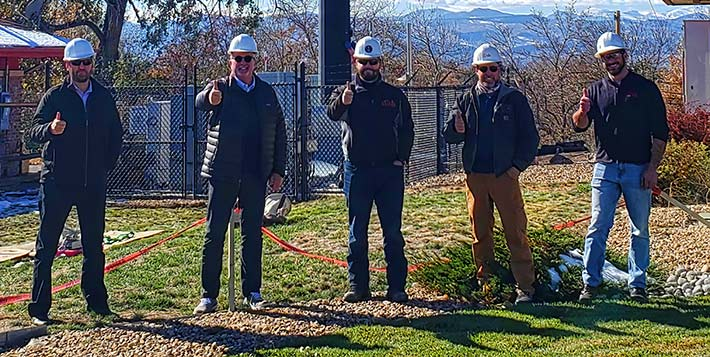Five thumbs up from Dish's development team after a successful test of their first cell site